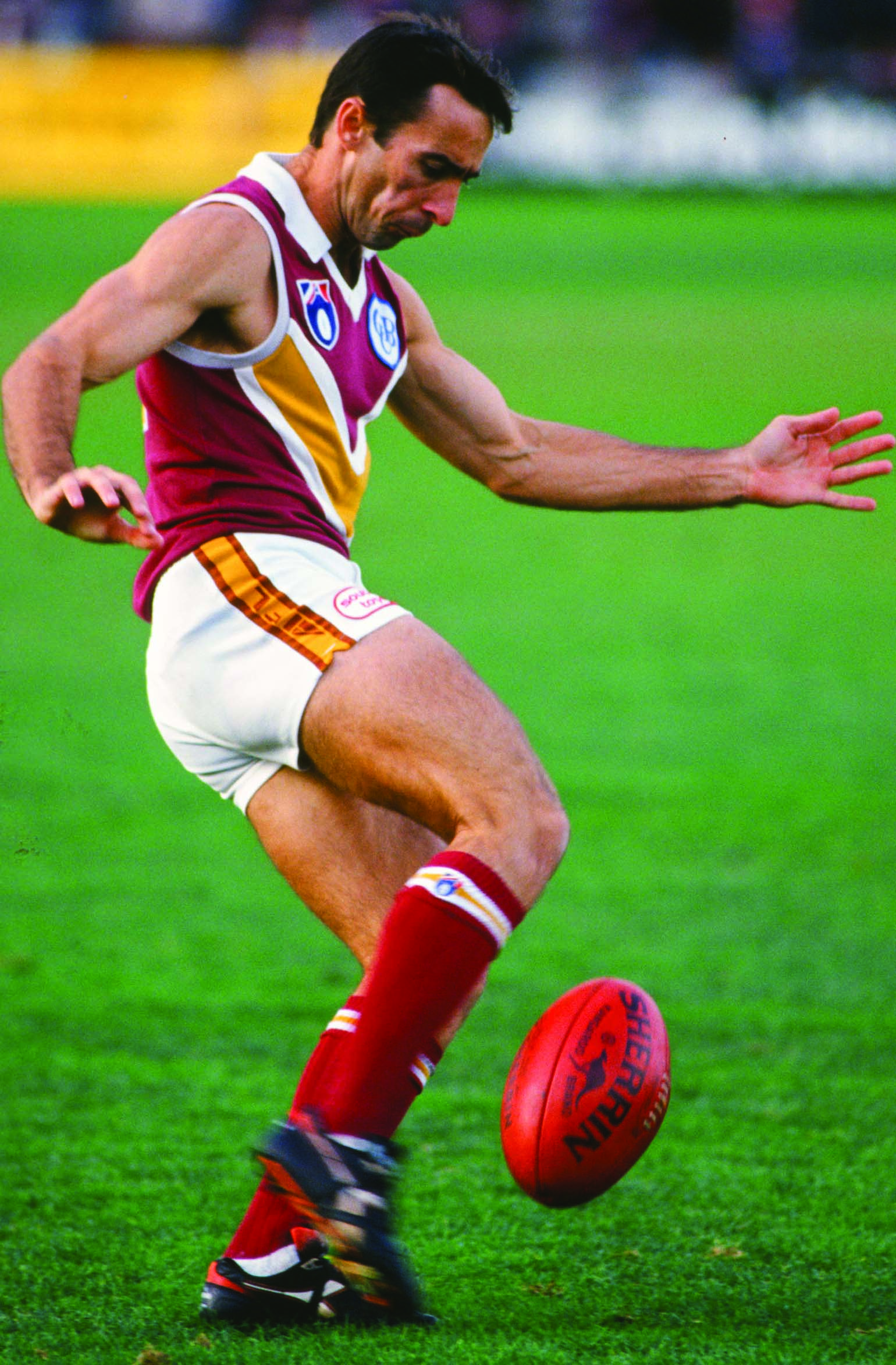 Troy Clarke of the Bears takes a kick during a 1993 round 13 AFL match between Footscray and the Brisbane Bears.