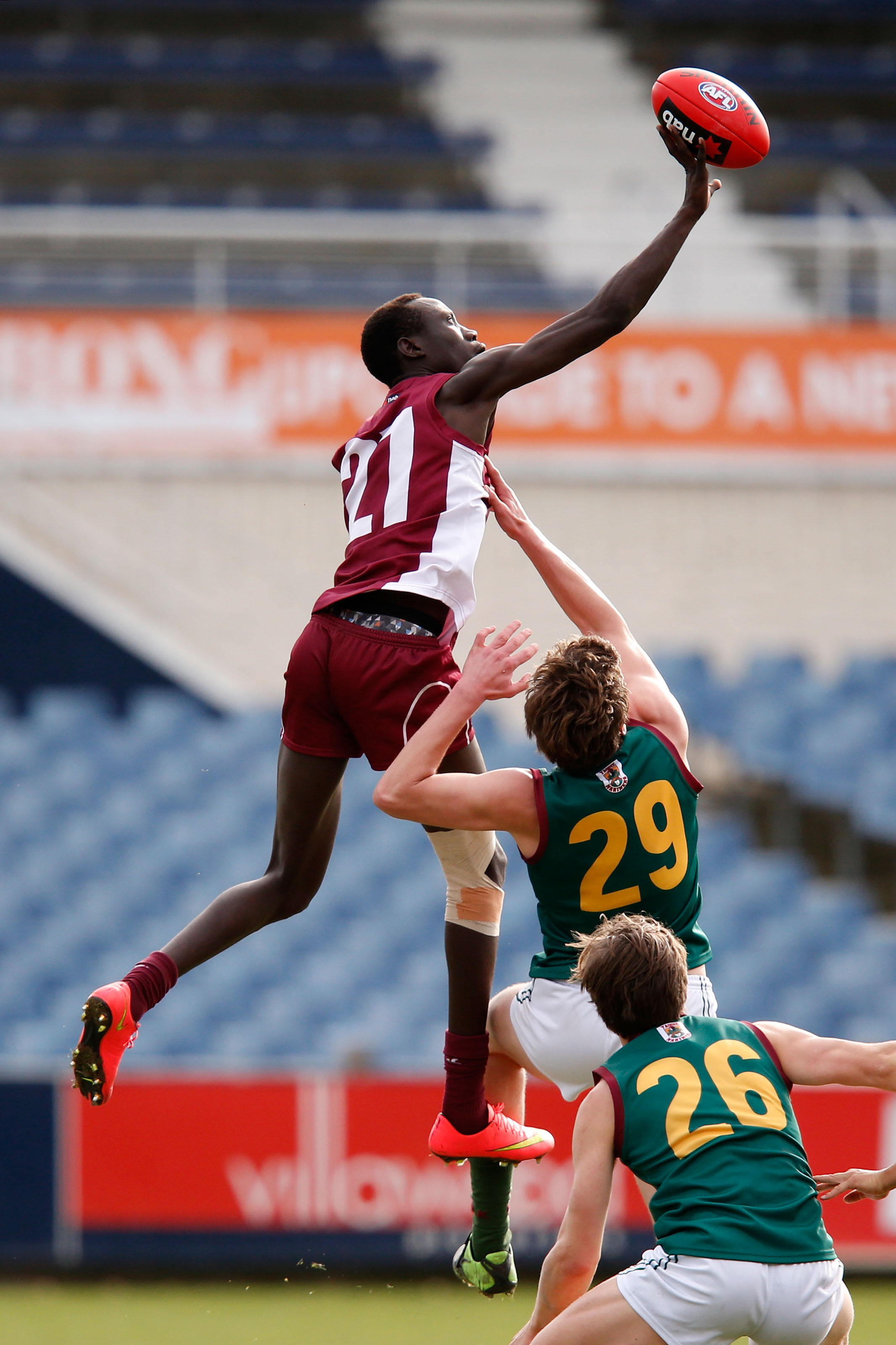 GEELONG, AUSTRALIA - JUNE 27: Mabior Chol of Queensland wins a ruck contest during the 2015 AFL Under 18 match between Queensland and Tasmania at Simonds Stadium, Geelong on June 27, 2015. (Photo by Darrian Traynor/AFL Media)