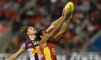 GOLD COAST, AUSTRALIA - JULY 09: Tom Nicholls of the Suns competes for the ball against Eric Hipwood of the Lions during the 2016 AFL Round 16 match between the Gold Coast Suns and the Brisbane Lions at Metricon Stadium on July 9, 2016 in Gold Coast, Australia. (Photo by Matt Roberts/AFL Media)