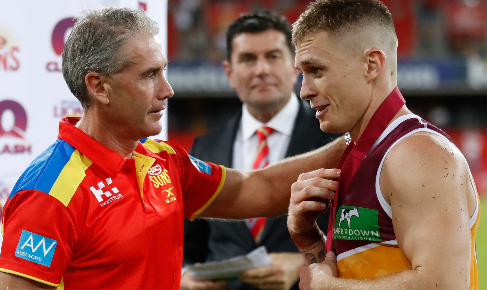 GOLD COAST, AUSTRALIA - MARCH 25: Marcus Ashcroft presents Dayne Beams of the Lions with the Marcus Ashcroft Medal during the 2017 AFL round 01 match between the Gold Coast Suns and the Brisbane Lions at Metricon Stadium on March 25, 2017 in Gold Coast, Australia. (Photo by Michael Willson/AFL Media)