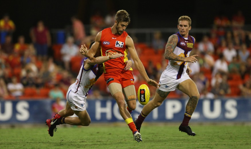 Seb Tape of the suns in action during the 2015 NAB Challenge Week 4 match between the Gold Coast Suns and the Brisbane Lions at Metricon Stadium, Gold Coast on March 20, 2015. (Photo: Jason O'Brien/AFL Media)