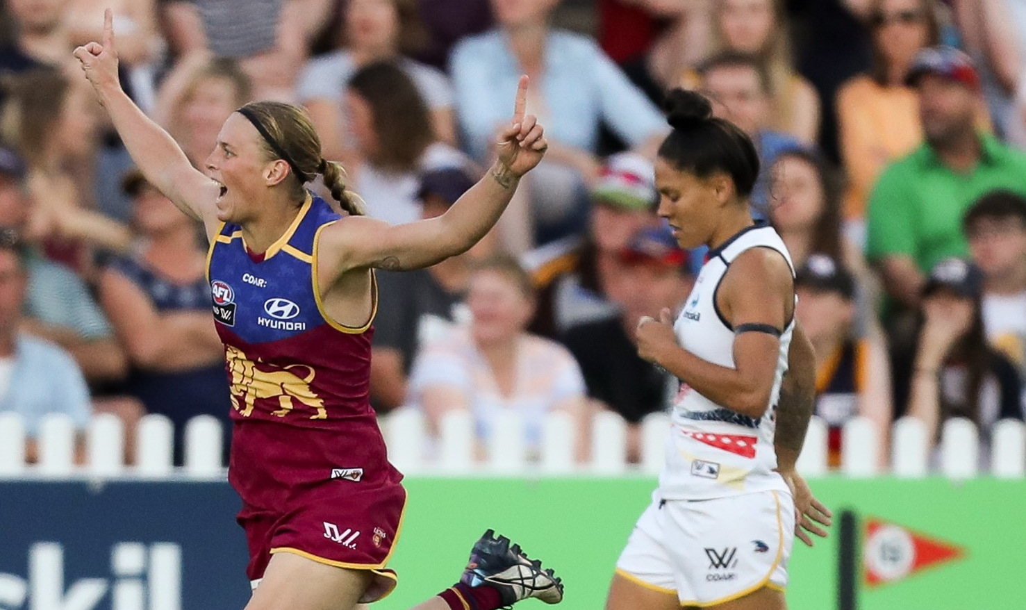 ADELAIDE, AUSTRALIA - MARCH 4: Kate Lutkins of the Lions celebrates a goal during the 2017 AFLW Round 05 match between the Adelaide Crows and the Brisbane Lions at Norwood Oval on March 4, 2017 in Adelaide, Australia. (Photo by AFL Media)