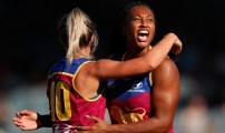 MELBOURNE, AUSTRALIA - MARCH 19: Sabrina Frederick-Traub of the Lions celebrates a goal with Kaitlyn Ashmore of the Lions  during the 2017 AFLW Round 07 match between the Carlton Blues and the Brisbane Lions at Ikon Park on March 19, 2017 in Melbourne, Australia. (Photo by Adam Trafford/AFL Media)