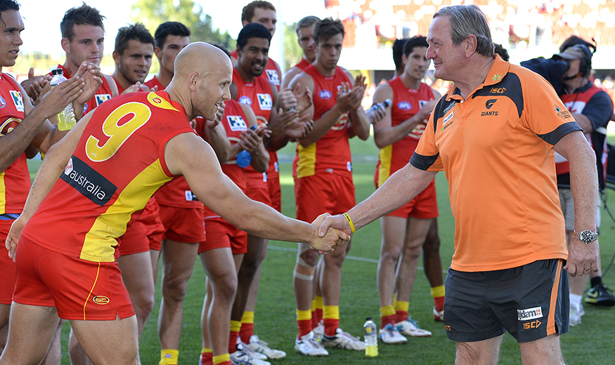 Coach Kevin Sheedy is congratulated and farewelled by Gary Ablett of the Suns as he leaves the field after the 2013 AFL Round 23 match between the Gold Coast Suns and the GWS Giants at Metricon Stadium, Gold Coast on September 01, 2013. (Photo: Bradley Kanaris/AFL Media)