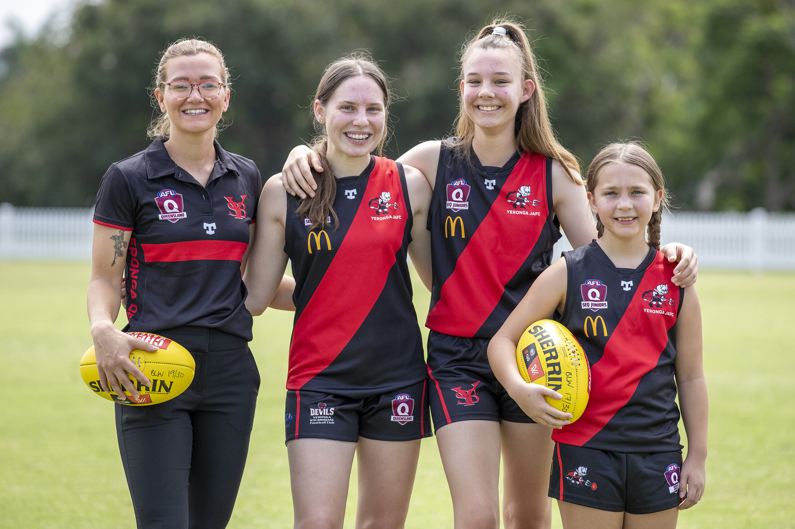 Jamie Howell is joined by junior players from the Yeronga South Brisbane Football Club